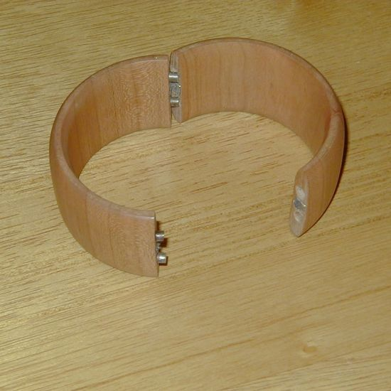 A cuff bracelet for my sister (Cherry wood) The bracelet snaps together with magnets.